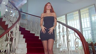 Magnificent ginger babe Agatha is posing on the stairway