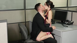 Jolly Jane Wilde gets her sexual fix at the desk in the office